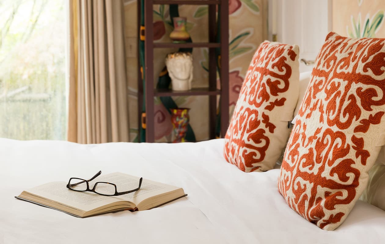 book on bed of boutique inn in Portland