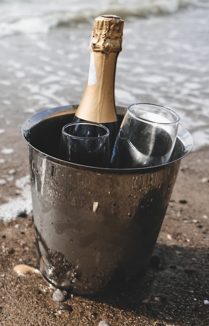 Champagne in an ice bucket on the beach